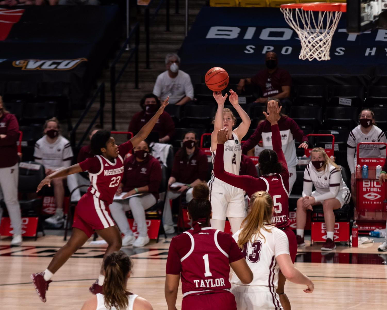 anna dewolfe jumps to shoot a basketball in the a10 tournament game