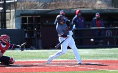 labella swinging a bat in a game against njit