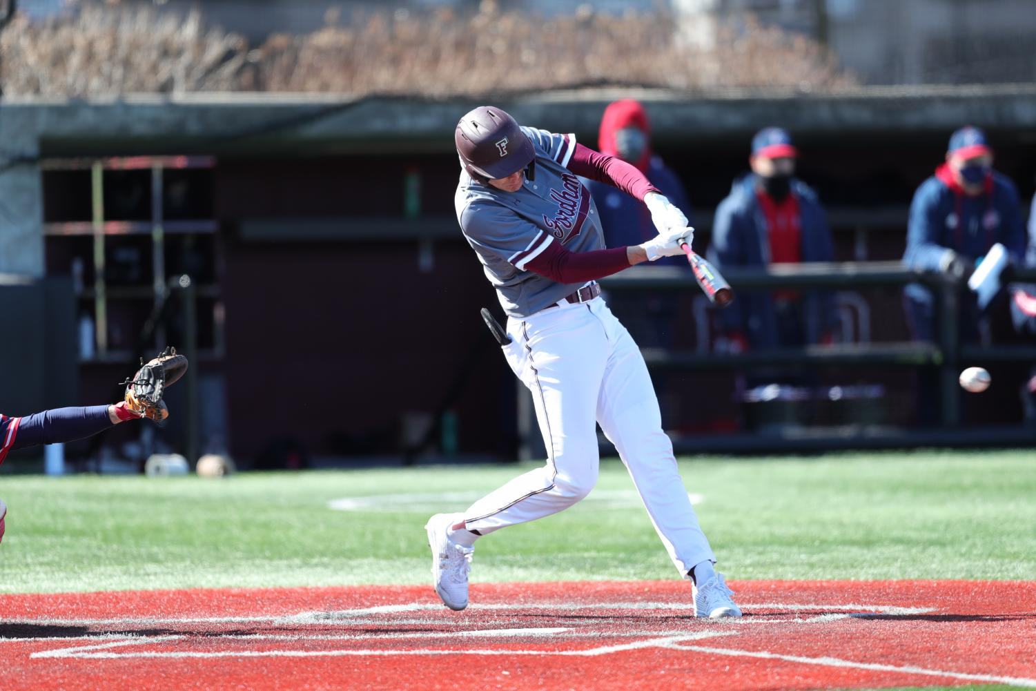 jason coules swinging a bat in the njit game