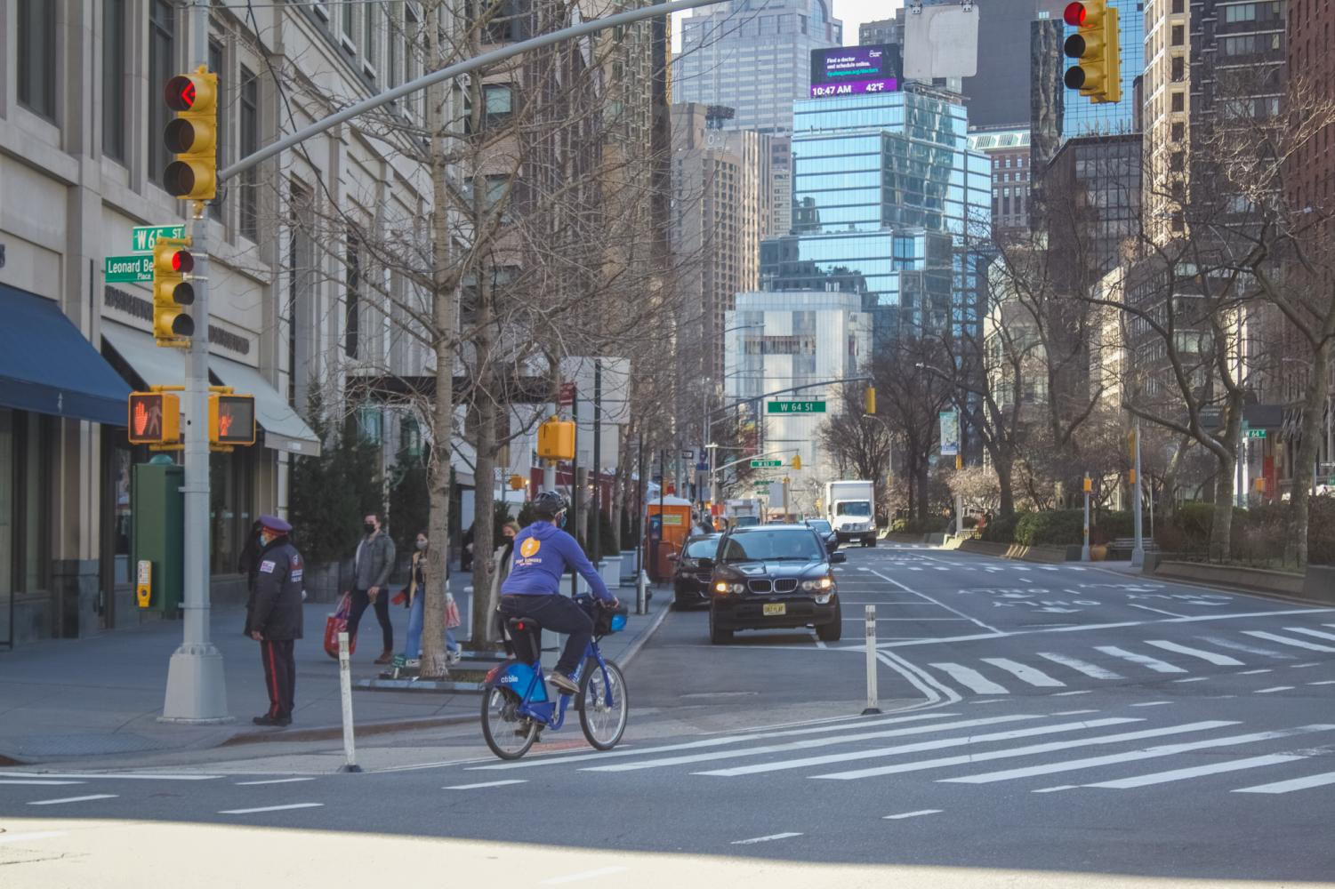 photo of cyclist on the new york street in spring