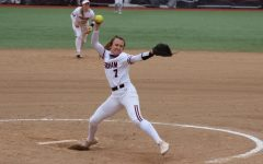 in a game against seton hall, woman pitches a softball