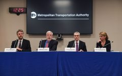 four people sitting at a table for a press conference on the MTA