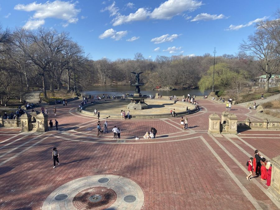 Photo of people walking around bethesda fountain on a sunny day in Central Park
