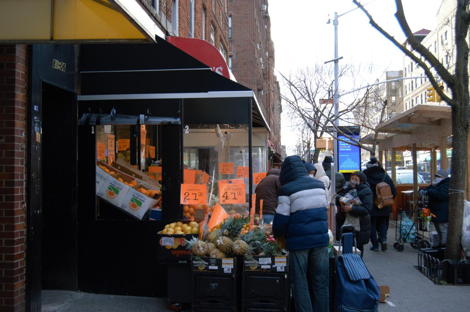 person shopping for produce in jackson heights
