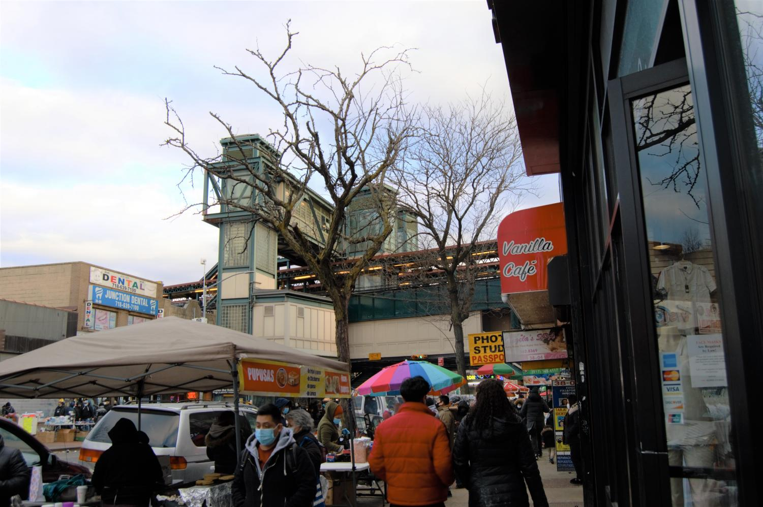 sidewalk and the 7 train in jackson heights