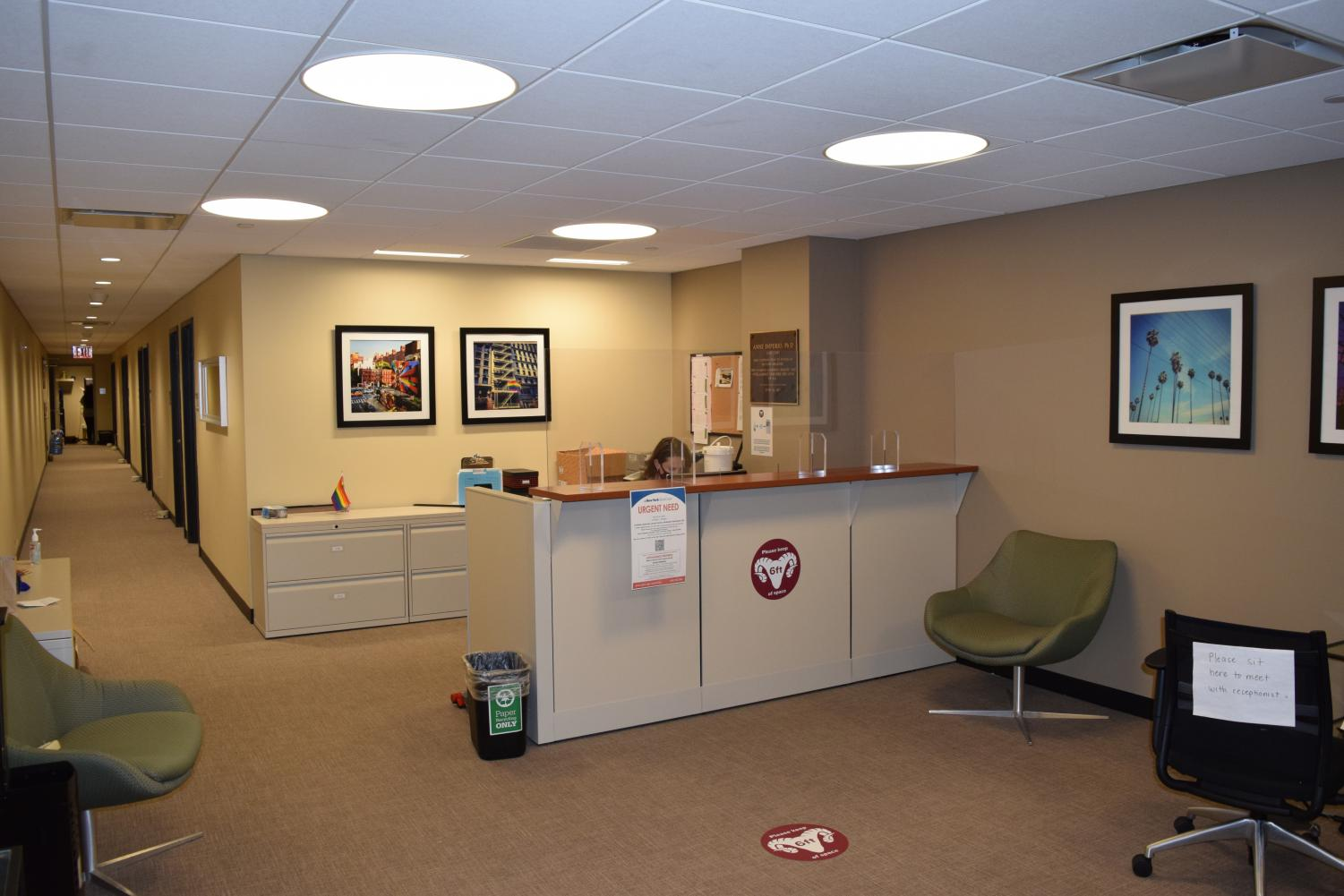 for an article about mental health, the office of counseling at fordham, with a person sitting at a front desk in a beige room