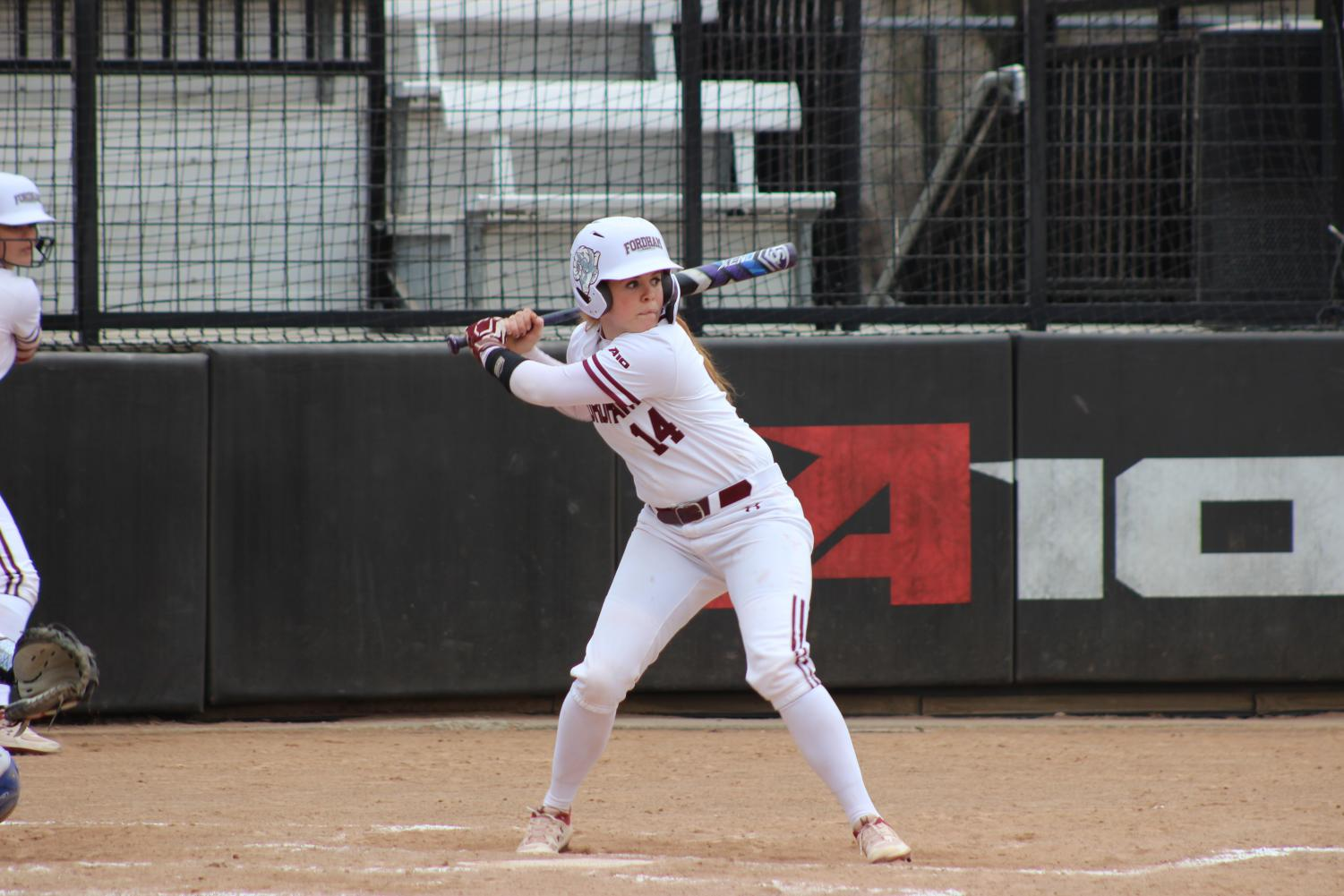 girl holding a bat in game against seton hall