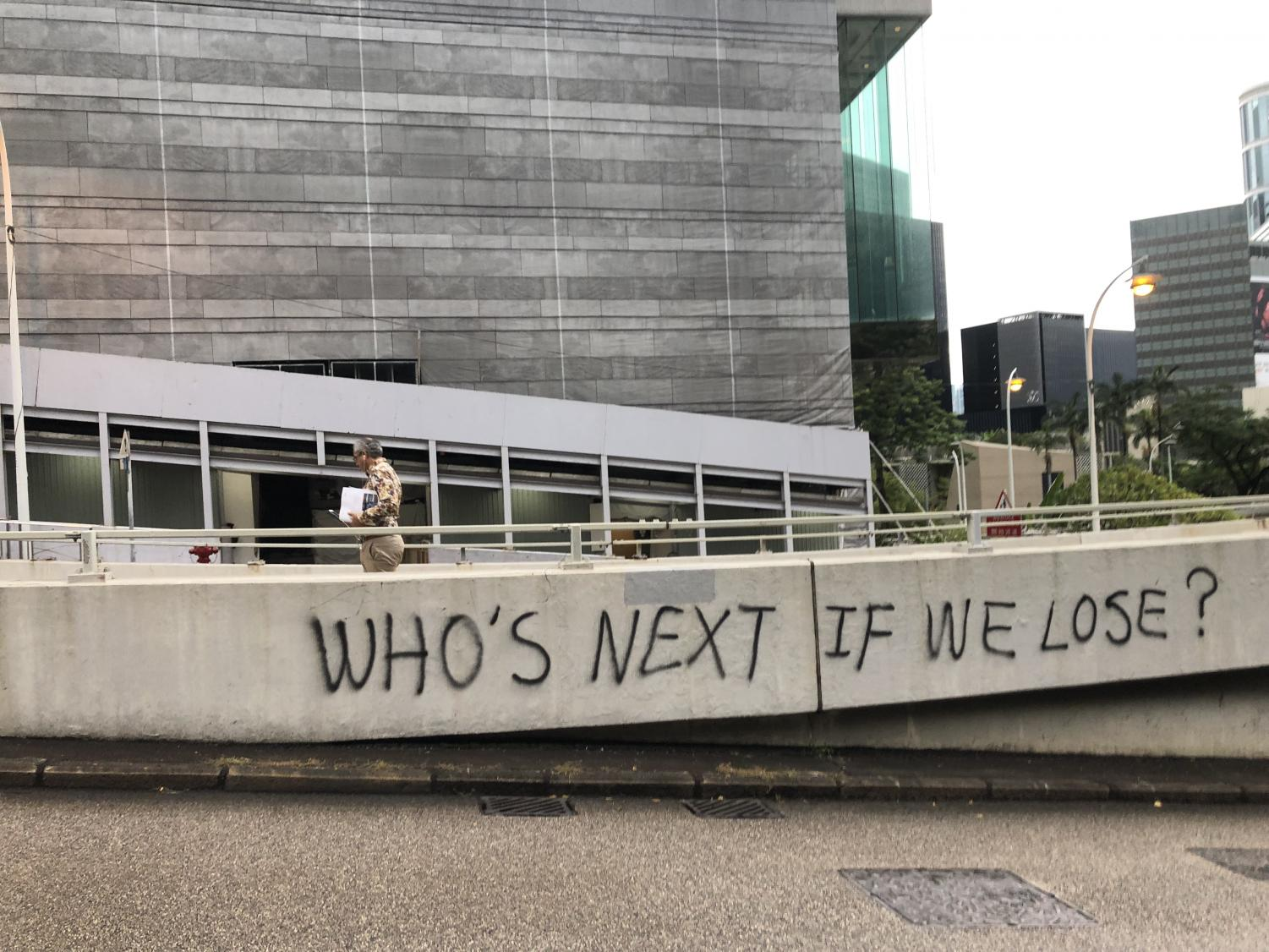 "for an article about the national security law, graffiti in hong kong that reads ""who's next if we lose?"""