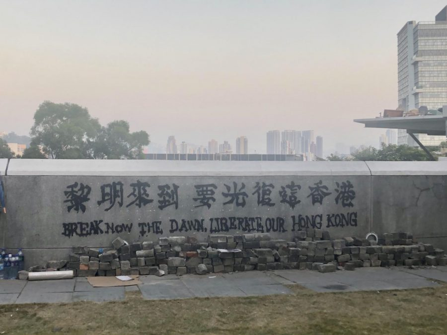 "for a story about the new national security law in hong kong, photo of graffiti in hong kong that reads ""break down the dawn, liberate our hong kong"""