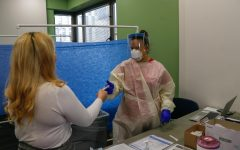 student getting an observed covid test at an on-campus testing center