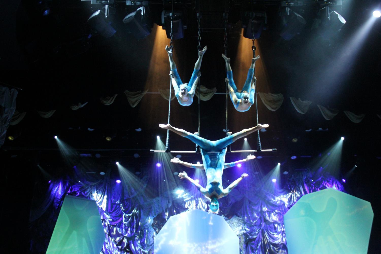 jennifer nau on a trapeze in blue lighting