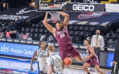 fordham player hanging off the rim of the basket during the game against george washington