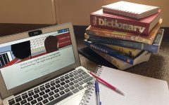 for an article about midterms, a photo of a laptop and books