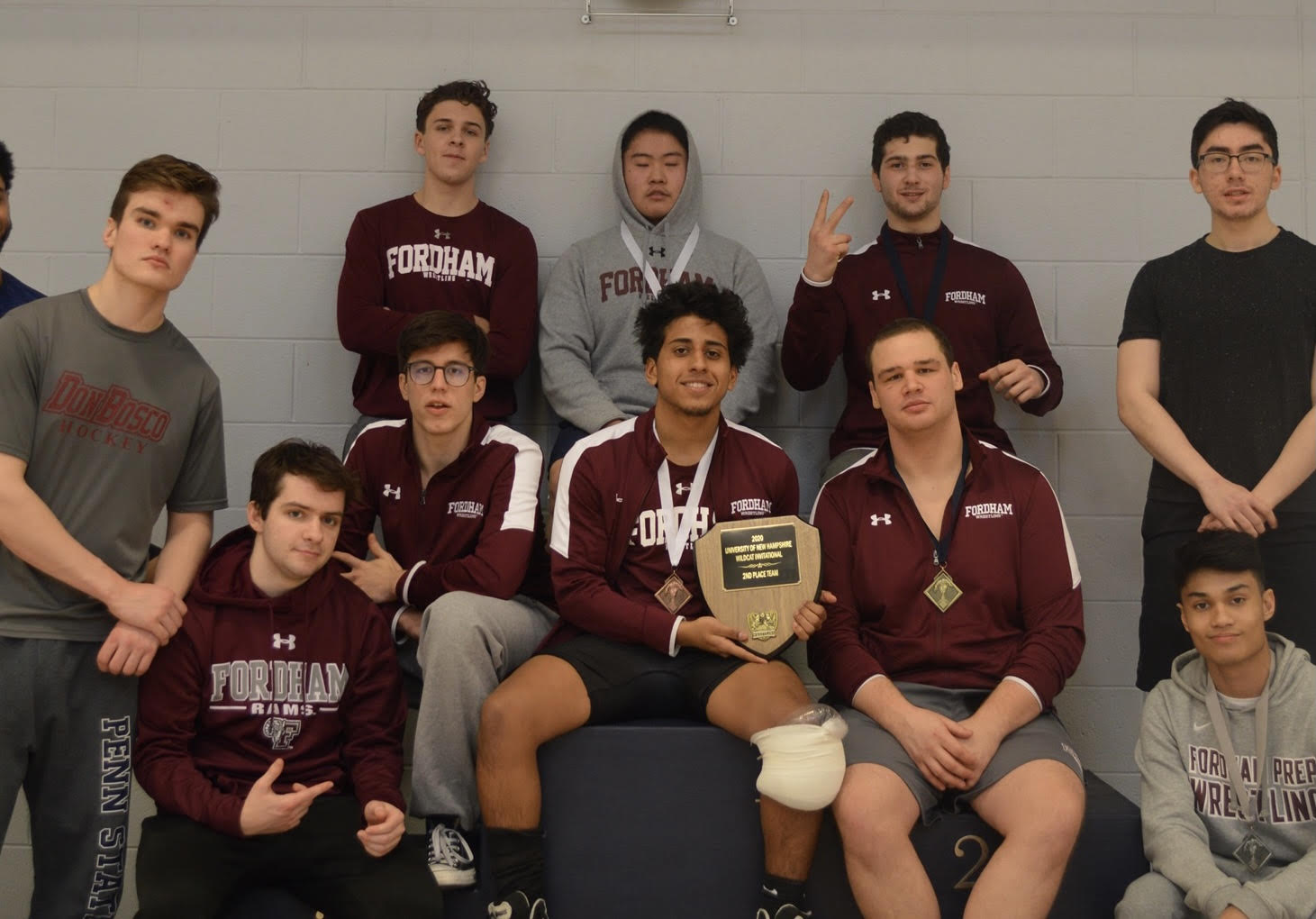 Juan Rodriguez poses with the rest of the Fordham men's wrestling team