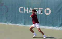 Fordham men's tennis player readies their racket at a match ahead of a possible championship.