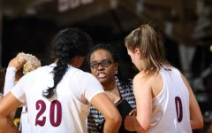 assistant coach Sonia Burke directs women's basketballplayers during a game