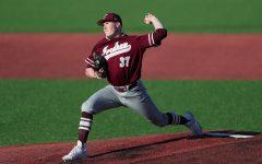 Fordham baseball player throws a baseball.