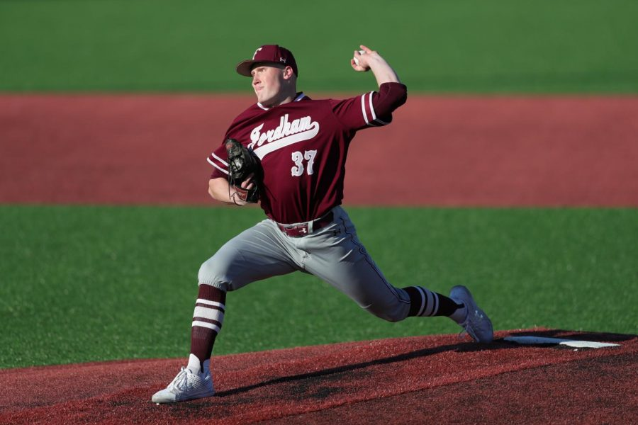 Fordham baseball player throws a baseball.