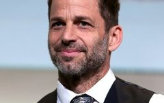 Justice League director Zack Snyder posing at a press event.