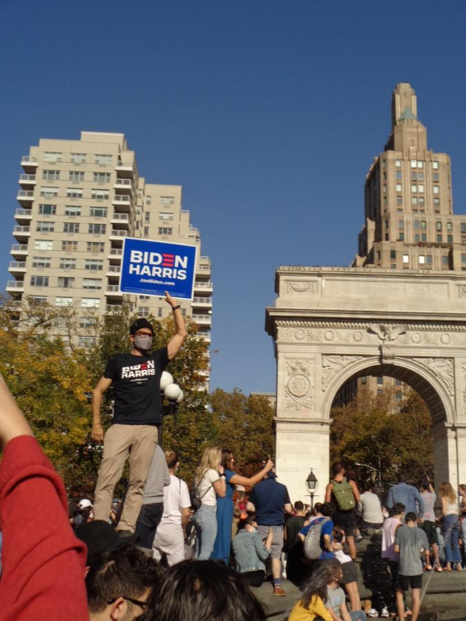 for an article about covid-19 photos, people celebrate at Washington Square Park for the election of Joe Biden and Kamala Harris in November 2020