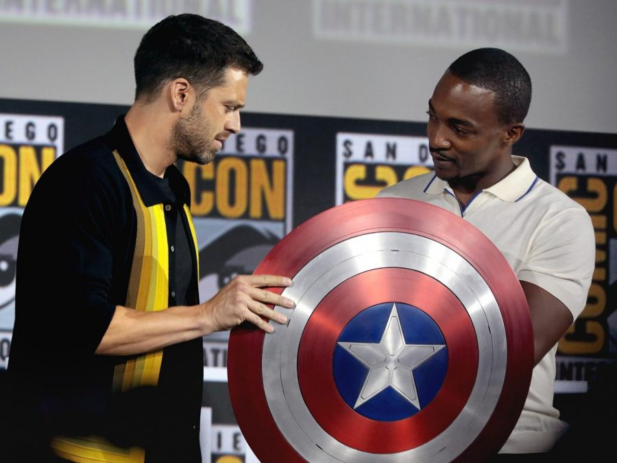 Falcon and Winter Soldier actors Sebastian Stan and Anthony Mackie stand at SDCC with the Captain America shield