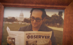 Mitch Berger holding a copy of the CLC Observer.