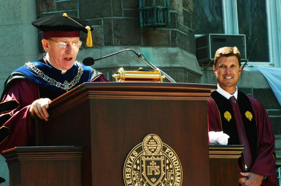 one of Fordhams main administrators, Rev. Joseph McShane, gives a speech at commencement years ago