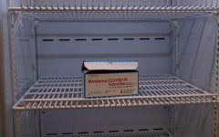 The Moderna two-shot vaccine is shown in a fridge.