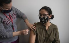 Photograph of a Fordham student receiving her COVID vaccine.