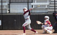 A Fordham softball player swings her bat in a series where Devon Miller had her third no-hitter.