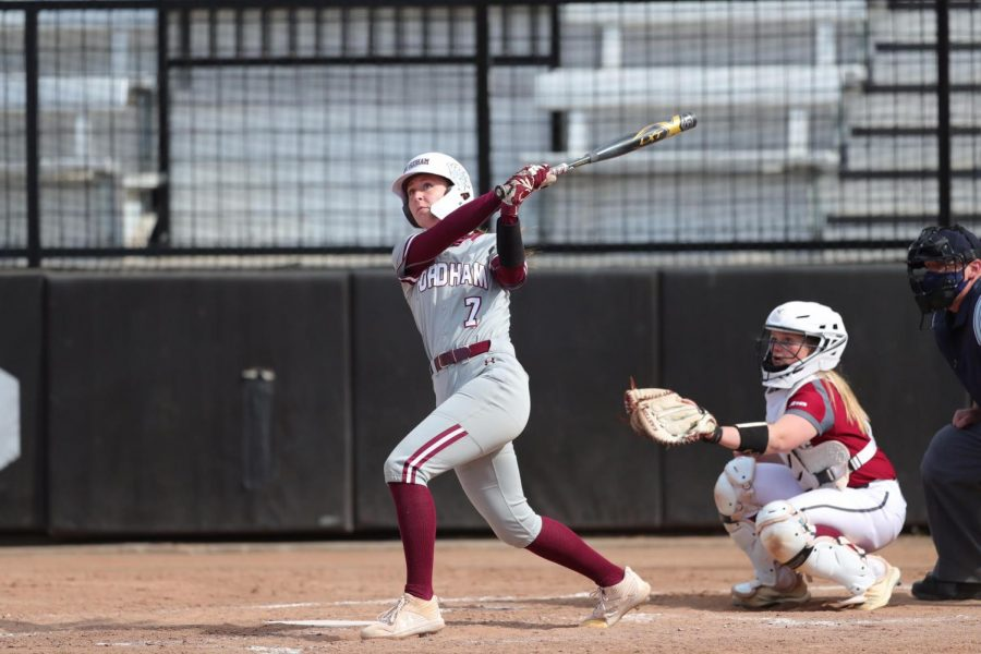 A Fordham softball player swings her bat in a series where Devon Miller had her third no-hitter.