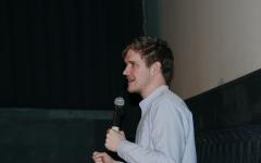 Bo Burnham performs holding a microphone
