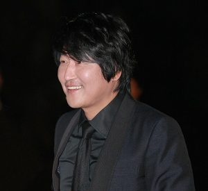 Song Kang-ho, a breakout South Korean actor, pictured in an all black suit.