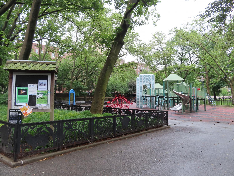 a playground in a park, featuring a Washington Bridge repplica