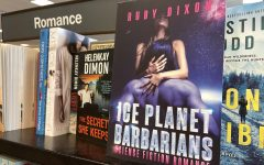 A book titled Ice Planet Barbarians by Ruby Dixon, a paranormal romance author