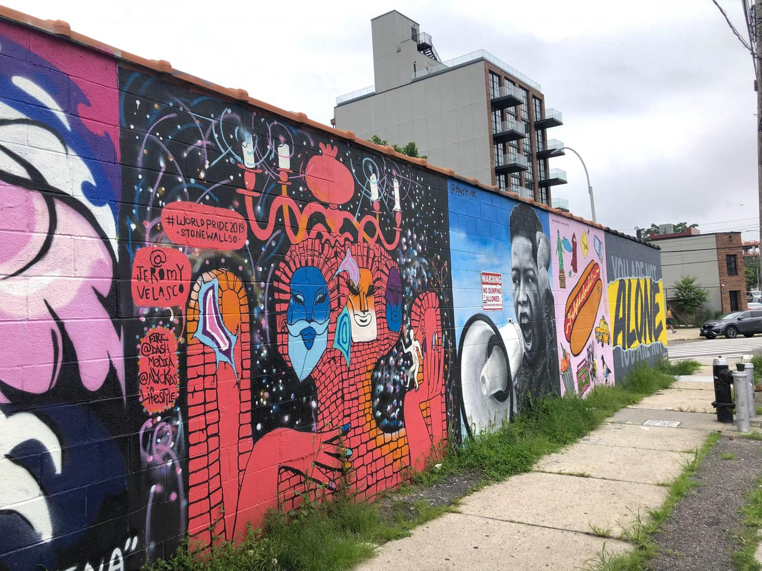 red and black street art on concrete, the Welling Court Mural Project
