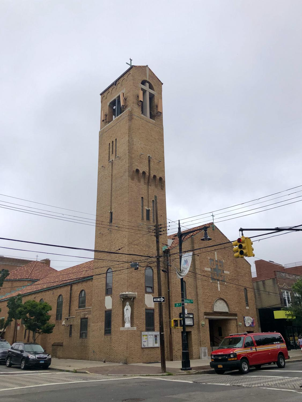 tall belltower of a Roman Catholic church in Astoria