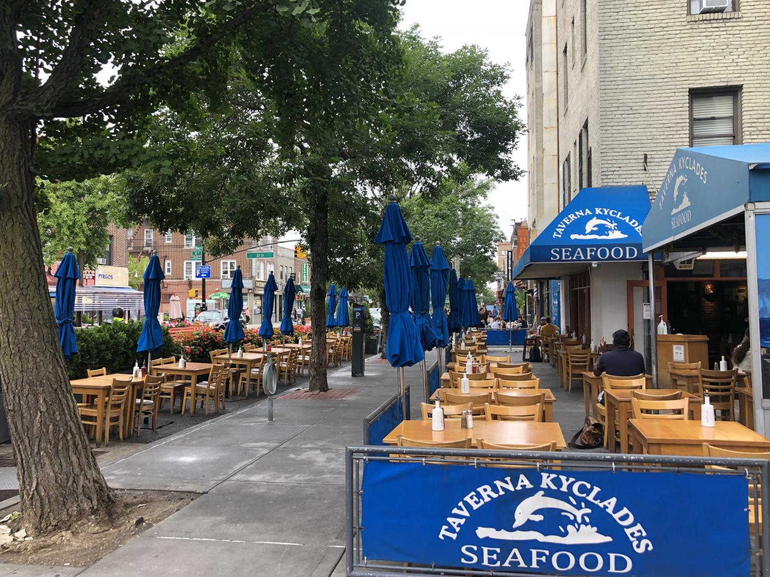 Taverna Kyclades Seafood and its blue signs on the street
