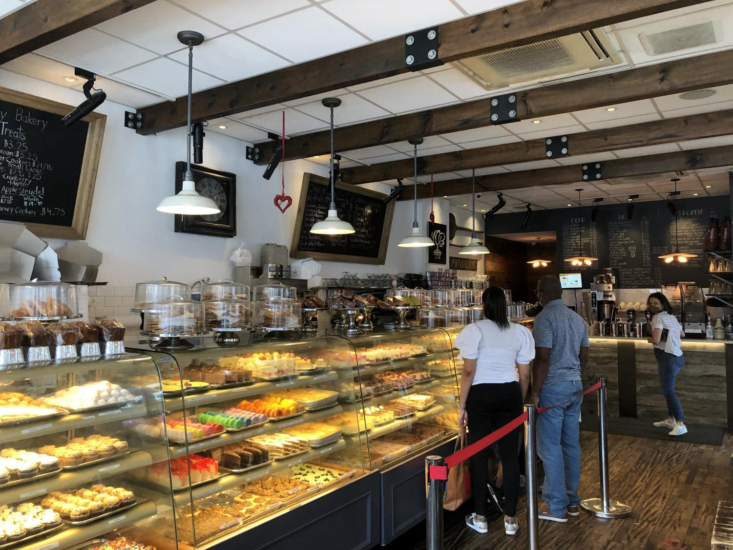 Inside of Martha's Country Bakery in Astoria, many baked goods line lit shelves behind glass