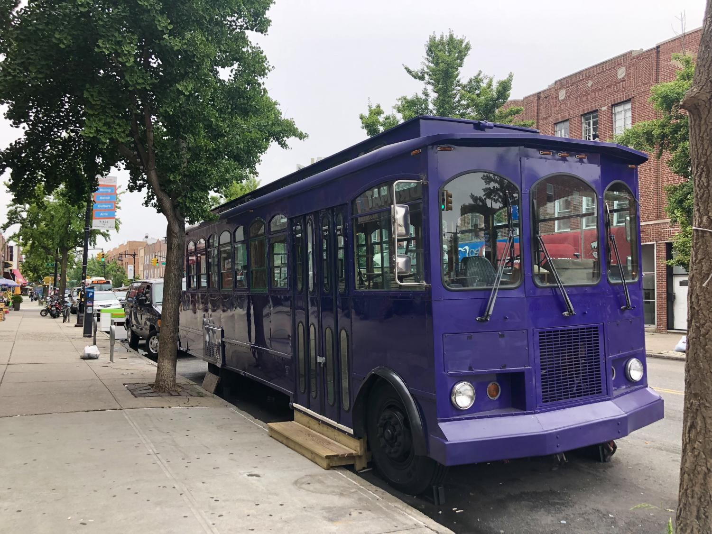 a purple trolley on Ditmars Boulevard