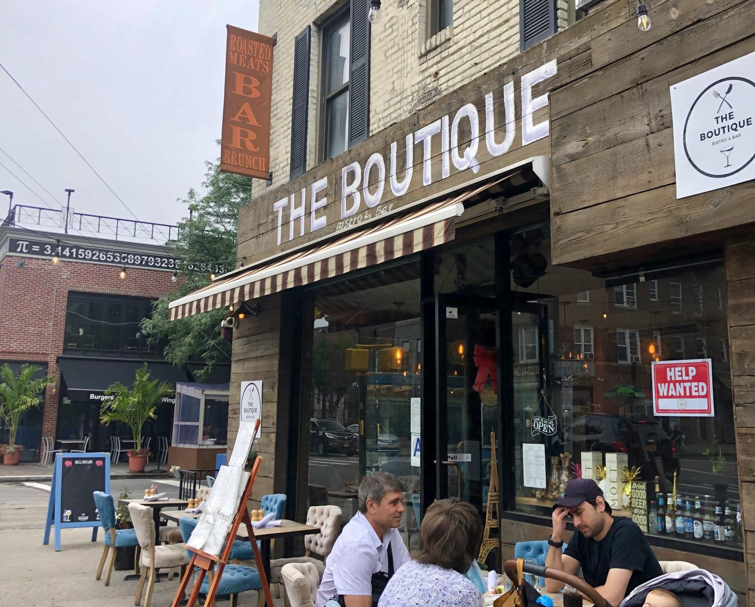 the boutique, a restaurant in Astoria, with outdoor seating