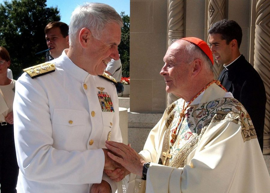 at left, Admiral William Fallon greets then-Cardinal McCarrick in a 2001 photo following the 9/11 terrorist attacks