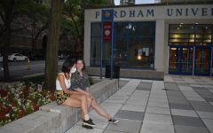students on the LC plaza, mask mandate in place at Fordham