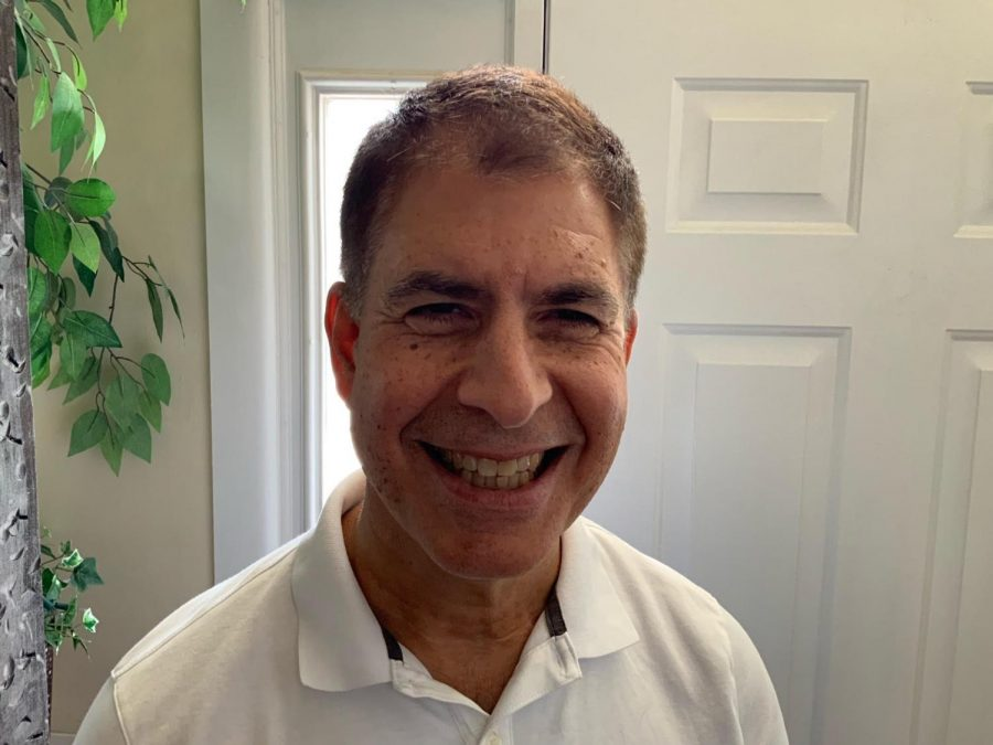 an image of John Cecero, the new VP of Mission Integration and Ministry, in a white polo shirt