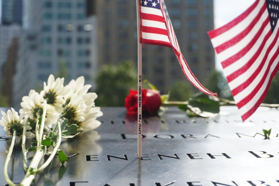 an image of a flag in a name at the 9/11 memorial