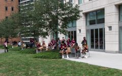 first-year students sitting outside their dorm building, Mckeon hall