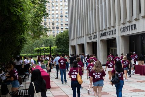 for an article about housing, first-year students gather at orientation wearing Ram Fan 25 shirts