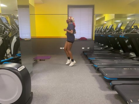 girl working out in fitness center of McMahon hall