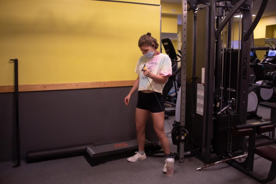 girl works out in the McMahon fitness center