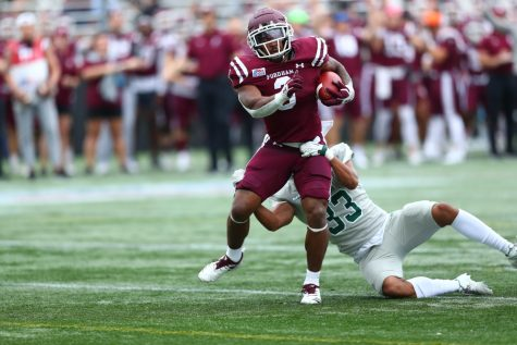 trey sneed runs with the ball at wagner game